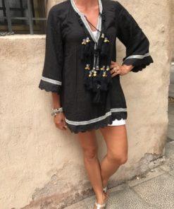 svart tunika med toffsar