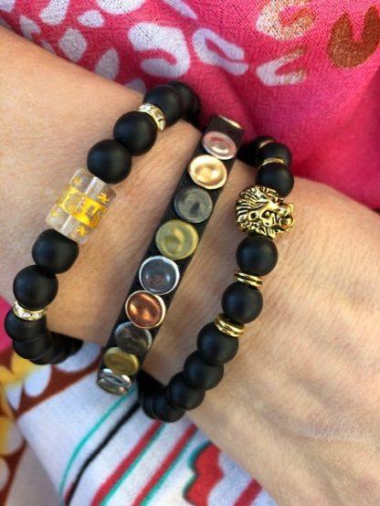 armbands set svart och guld med lejon