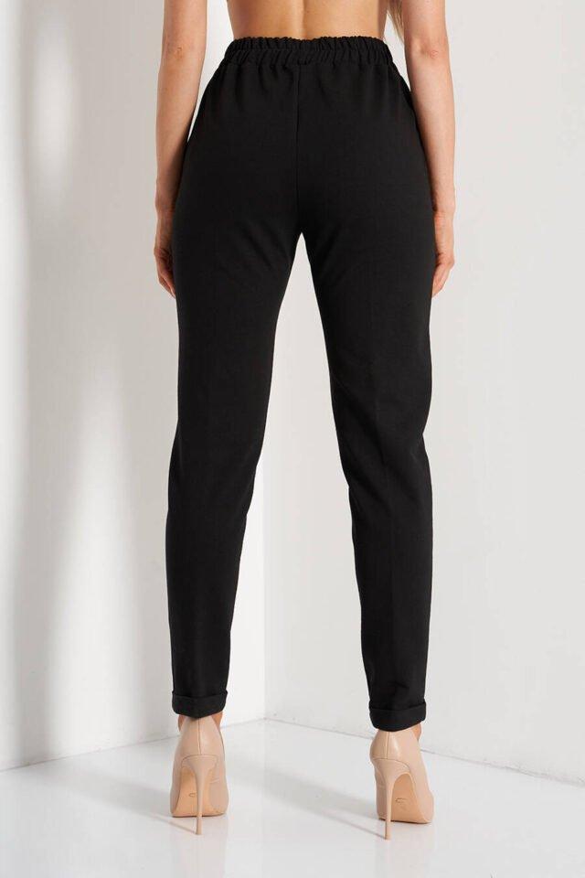Svarta byxor för företagskvinnor på kontoret